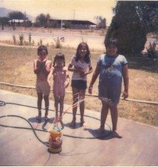 Here I am with my cousins and brother, ca. 1980.  I stick out like a sore thumb.